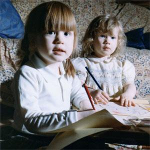 Alice aged 4 drawing with her little sister